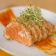 Seared salmon sashimi with a sesame seed crust :) - - A beautiful seared salmon filet encrusted with sesame seeds is turned into delicious sashimi slices, see how you too can make this delicious recipe. Sushi Recipes, Asian Recipes, Cooking Recipes, Healthy Recipes, Fish Dishes, Seafood Dishes, Seafood Recipes, Seared Salmon Recipes, Salmon Sashimi