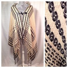 Outerwear Boho Cape: NWT NEW with tags. Cream and black, hooded, fringe cape. One size fits all. Offers accepted, ask questions if needed. Sweaters Shrugs & Ponchos