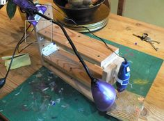 PCB Drill Press by yellowduck -- Homemade miniature drill press fabricated from wooden planks, four hinges, and ordinary springs. Powered with a Dremel-type rotary tool and useful as a light-duty drill press for thin material such as printed circuit boards. http://www.homemadetools.net/homemade-pcb-drill-press