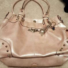Kathy Zeeland light pink purse Used Kathy Zeeland light pink purse pen stain on inside of one compartment  very cute bag still has good use to itno hokes ot tears just used see pics for details. Kathy Van Zeeland Bags Shoulder Bags