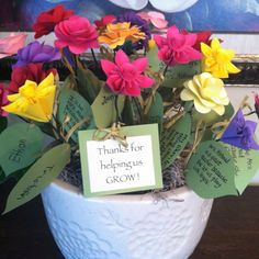 Teacher Gift. Each child said what they liked about their Kindergarten teacher.   We wrote it on a leaf and had them write their name on the back. Leaf tied with raffia to a handmade paper flower (see Etsy) then stuck in styrofoam in a pot and hidden with Spanish moss. Child will present flower at last day of school party.