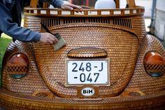 wood-covered VW Beetle