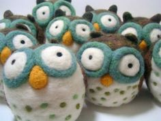 these are woolbuddy's owls!  woolbuddy.com.  went to a workshop he did when i was in san francisco.  my owl looks a little different...