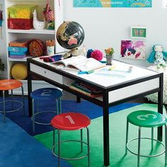 "The vintage-inspired design of The Land of Nod's Numeral Metal Stool coordinates with all of their 23"" play tables.  The stools are made of powder coated steel, which means they'll last for longer than you can count."