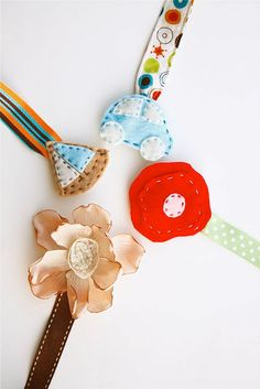 Pacifier clips. I have been wanting to make these with cute flowers. I love the idea of these ironing board clips.