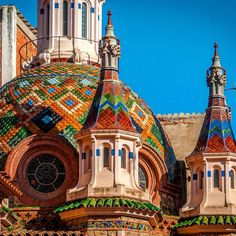 The colorful domes of the church of Sant Roma in Lloret de Mar, Catalonia.