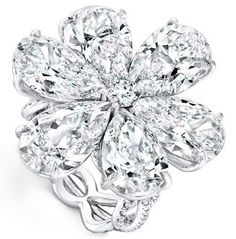 Flower shaped diamond composed of pear shaped petals and a round cut diamond in the center.