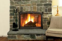 How to build a stone-veneer fireplace surround that adds rustic charm to any hearth, for a fraction of the cost of the real thing. | Photo:  | thisoldhouse.com