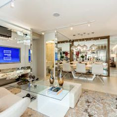 CYRELA_Varanda Tatuapé 102m²: Salas de estar clássicas por Chris Silveira & Arquitetos Associados