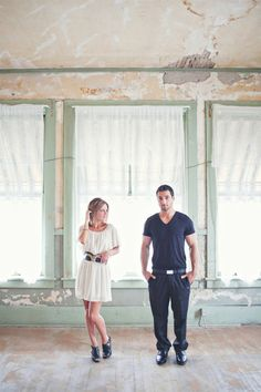 This couple found their dream location for their engagement photo shoot - a vintage warehouse loft. Photos by Amanda K Photography via JunebugWeddings.com