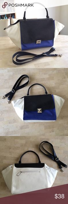Black Blue White Color Block Crocodile Print Bag STUNNING color blocked handbag / bag / tote / purse in black, off-white, & royal blue w/ large silver-tone flattened pyramid magnetic clasp. Croc print embossed faux leather. 1 handle as handbag. Comes w/ detachable shoulder strap. 1 zipper pocket on back, 1 zipper pocket inside & 2 pouch pockets inside. Large size, chic way to carry supplies for work or school or even a weekend travel tote. Pretty light weight! BRAND NEW!! Purchased online so…