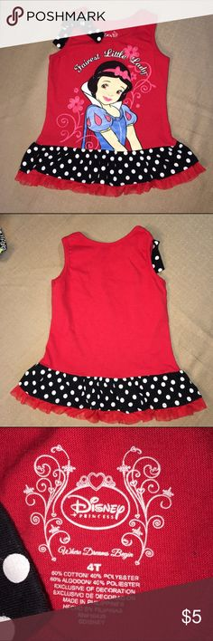 "Girls Snow White Top Girls size 4T. Disney Snow White ""Fairest Little Lady"" red sleeveless top with polka dot & ruffle hem. Matching polka dot bow on strap. Excellent condition. No cracking or peeling of print.   Fabric: 60% Cotton, 40% Polyester Disney Shirts & Tops Tank Tops"
