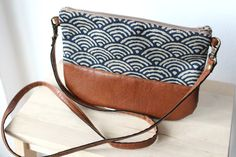 Crossbody leather and fabric bag great for every day use. It will fit your most essential things inside such as phone, keys, wallet... The strap is