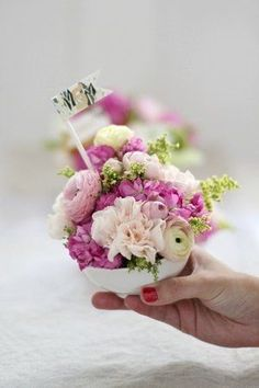 Place Card Mini Florals: For any spring or summer party, make guests feel extra special by having a mini arrangement as a place card at the dinner table.