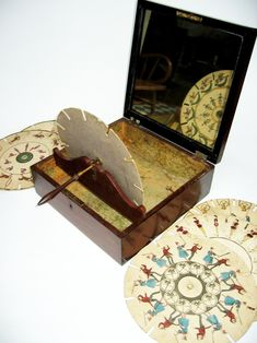 To see the images on the discs designed for this English Phenakistoscope, c. 1835, viewers would look through the slots in the discs and see the animations in the mirror.