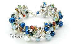 Delikatna bransoletka wykonana ze szklanych czeskich koralików i perełek.