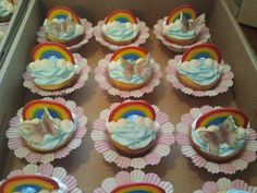 butterfly cupcakes with rainbows for a little girls birthday....
