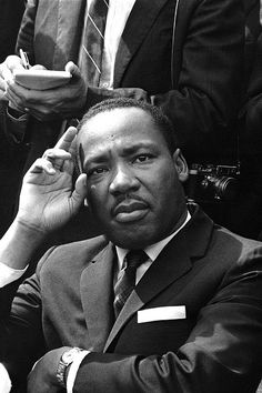 We Remember Dr. Martin Luther King, Jr.  - In this Sept. 16, 1963 file photo, Dr. Martin Luther King Jr. gives a news conference in Birmingham, Ala. | Black America Web