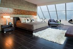 Sloped wall of windows in master bedroom--how nice would that be when it rains?! | Fregolle Residence by Cantoni