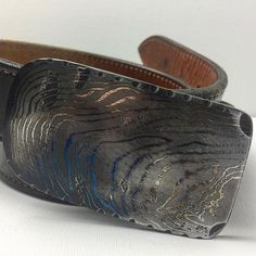 $145 shipped in lower 48 only - 77 layer buckle - belt not included. DM if interested #forgedfromtexas #damascussteel #damascus #knifemaker #blacksmith #blacksmithing #forsale #handmade #designer #apparel #mensfashion #clothes #leather #steel