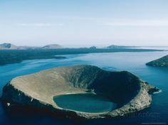 The Galapagos Islands are a series of small volcanic islands in the Pacific Ocean, about 972 kilometers west of Ecuador, and form a national park and biological marine reserve. Description from pinterest.com. I searched for this on bing.com/images
