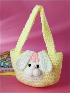 Bunny Purse Crochet Pattern Download from e-PatternsCentral.com -- A friendly, floppy-eared bunny peeks from the front of this quick-to-stitch purse.
