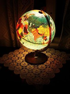 Globe Lamp. My brother has one of these in his somewhat nautical/traveller-themed bedroom. He uses it as a night light.