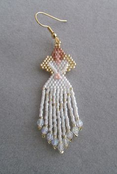 These beaded Angel earrings are just the thing at any time of the year for the Angel aficionado in your life. They measure about 1-inch wide and 2-1/2-inches long, excluding the ear wires and contain approximately 578 tiny delica seed beads, intricately woven together, one bead at a time, with a beading needle and beading thread, along with 18 czech firepolish beads to create the finished earrings you see here. These would make a great gift for the Angel in your life, or for someone you…