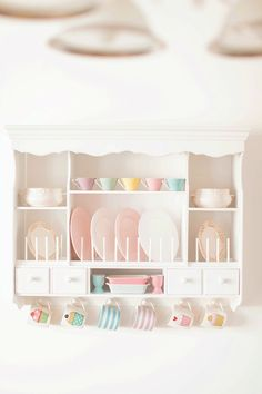 Do you love this wall mounted plate display unit?! I'm pretty certain it's the ikea plate rack. I must get one for my own pastel cottage kitchen. Heart Handmade UK: Perfect Pastel Slovenian Home!