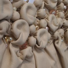 Fabric Manipulation sample using leather & beads to create raised 3D surface textures // Claire Goodwin #textiles