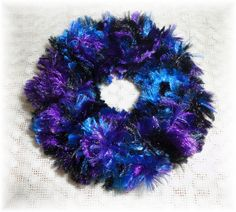 """A stunning blend of royal blue, purple & black in this fun hair scrunchie, pony tail holder. Made of soft & fluffy boa yarn, fun fur yarn, approximately 3"""" wide, on adult sized metal free pony tail elastics ... helps protect your hair from breakage from the elastics!  www.etsy.com/shop/ACCESSORIESBYEMM"""