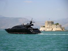 A luxury private yacht leaving the port of #Nafplio in the summer of 2013, while passing in front of #Bourtzi fortress.