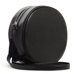 """NIKKI REED x FREEDOM OF ANIMALS BOROMO CIRCLE BAG Soft black faux leather 8"""" circle bag. Perfect from day to night with detachable shoulder strap. Tassel zipper pull. Made of post consumer, cruelty free, eco-faux leather. Vegetable dyed. Organic cotton lining. Easily cleaned with soap and water. Durable and water resistant. 8"""" x 8"""" x 2.5"""" strap is 40"""" x 5/8"""""""