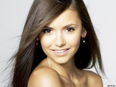 Nina Dobrev plays elena and katherine in the vampire diaries:)
