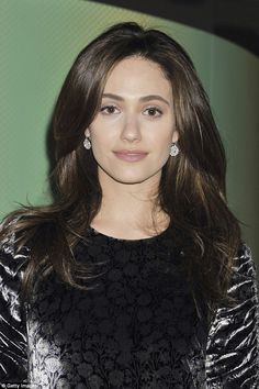 Pretty:Her straight brunette tresses were worn down flowing over her shoulders as she spo...