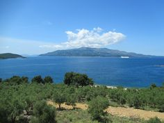 Corfu Island in Greece is visible across the Ionian Sea from the Albanian coast south of Saranda. Corfu Island, Greece Islands, Albania, Palermo, Coastal, Sea, Mountains, Nature, Travel