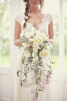 White Cascading Bridal Bouquet with white roses #bouquet #white #roses