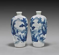 """Pair of antique, Chinese blue and white porcelain vases; each of ovoid form with small mouths, with continuous typical scene of figures in a rockery landscape; early 19th Century; H: 8 1/2"""""""