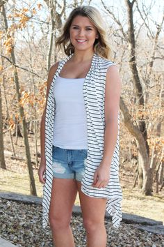 White jersey knit vest with black stripes. One size, fits loose and flowy. 100% Polyester