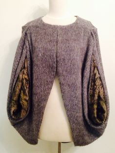 Cape. Grey wool with rainforest insert. $180 Campisi couture
