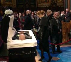 A prayer before the last farewell: The singing sensation approached the open casket with h...