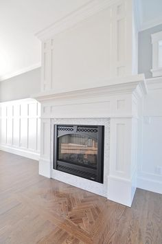 Craftsman fireplace mantel with board and batten wainscoting.