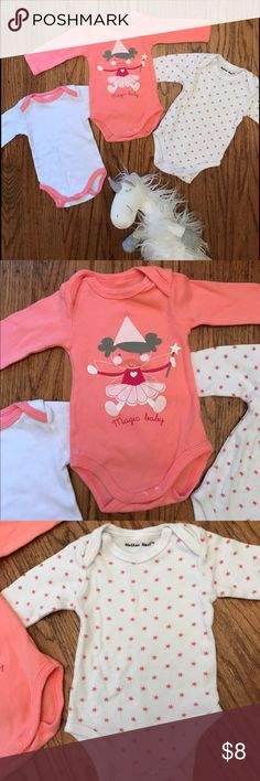 Long Sleeve Onesie Lot 3 long sleeve onesies from Mother Nest. There is no size information printed on/in the onesie, however, they are all size newborn. My daughter was able to wear them up to about 12-13 lbs. EUC. No stains, rips, or flaws. Mother Nest One Pieces Bodysuits