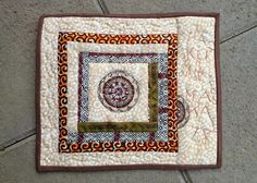 I finished this mug rug last weekend. It was an orphan log cabin block made of scraps.