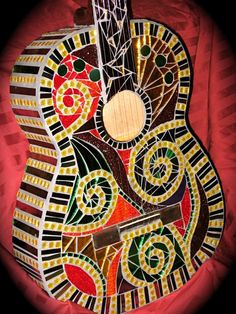 Mosaic Guitars by Cynthia Litwer, via Behance