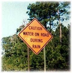 Redneck Caution Sign. No Kidding? Water on Road During Rain. Who Would Have Thought!
