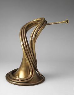 Cornet-trompe in D, ca. 1862 [attributed to Alphonse (Antoine) Sax]. This unusually wound hunting horn was designed to be more easily handled than the traditional large and unwieldy hooped horn used in the field to signal to members of the hunting party. Its ergonomic form enables it to be tucked snugly under the arm against the player's body for safe and convenient carrying. - Metropolitan Museum of Art