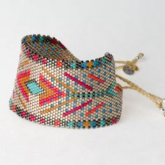 Modern tribal designed large cuff, Wing Ding is perfect to wear with a white T. This stunning composition of festival colors is handwoven in Colombia and made with glass beads.