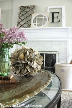 Love the effortless style of this antique window mantel in this gorgeous living room and especially love the coffee table accents and that oyster shell orb from HomeGoods! Such a beachy coastal feel for the summer. eclecticallyvintage.com sponsored pin