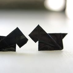 DIY Origami Scottie Dog Earrings. They are fun to make and even more fun to wear. Learn how with this tutorial!
